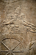 Assyrian relief sculpture panel of Ashurnasirpal on his chariot at the begining of a lion hunt.  From Nineveh  North Palace, Iraq,  668-627 B.C.  British Museum Assyrian  Archaeological exhibit no ME 124858 .<br /> <br /> If you prefer to buy from our ALAMY PHOTO LIBRARY  Collection visit : https://www.alamy.com/portfolio/paul-williams-funkystock/ancient-assyria-antiquities.html  Refine search by adding background colour, place, subject, museum etc into the LOWER SEARCH WITHIN GALLERY box to <br /> <br /> Visit our ANCIENT ASSYRIAN PHOTO COLLECTIONS for more photos to download or buy as wall art prints https://funkystock.photoshelter.com/gallery-collection/Ancient-Assyrian-Art-Artefacts-Antiquities-Historic-Sites-Pictures-Images-of/C0000cjRqQyJjLag