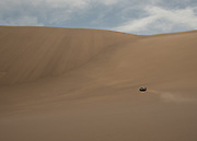 The expedition 4 x 4 cars getting deeper into the heart of the Lut desert.