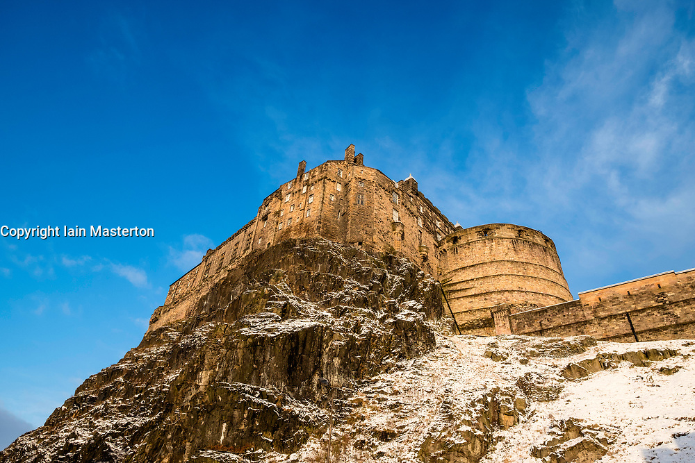 View of Edinburgh Castle from the Grassmarket after snowfall during winter in  Scotland, United Kingdom