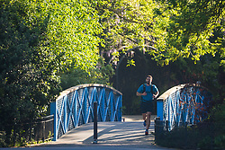 A runner crosses a bridge as a beautiful morning greets Londoners in Regents Park. London, May 09 2018.