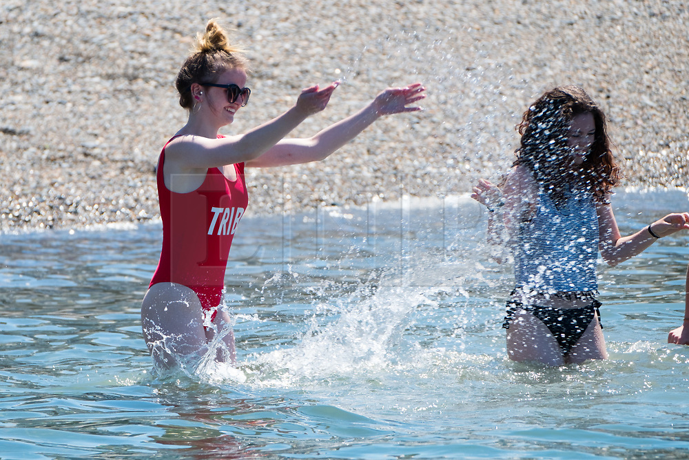 © Licenced to London News Pictures<br /> 28 June 2018 . Aberystwyth Wales UK<br /> <br /> UK Weather:  On another scorchingly hot day at the seaside in Aberystwyth, people flock to the beach and sea to top up their tans and cool down  a little in the clear shallow  waters of Cardigan Bay<br /> The UK is in the grips of a mini heatwave, with temperatures reaching over  30º Celsius in many parts of the country<br /> photo creditKeith Morris / LNP