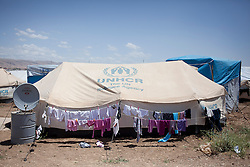 © Licensed to London News Pictures. 12/05/2013. Dohuk, Iraq. A tent provided by the UNHCR is seen inside a refugee camp in Iraqi-Kurdistan, set up for Syrians escaping the ongoing civil war. The camp, close to the city of Dohuk, now houses in the region of 45,000 refugees, with around 400 new arrivals every day. Photo credit: Matt Cetti-Roberts/LNP