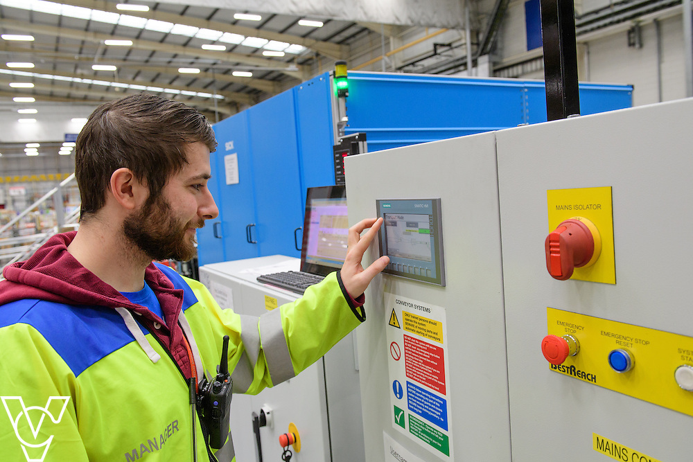 Royal Mail's Yorkshire Distribution Centre has got a new parcel scanning machine installed, part of a £1.7m investment in distribution centres, which helps increase the number of parcels scanned in a day.  Pictured is the new parcel scanning machine at the Yorkshire Distribution Centre.  Pictured is manager John Baxter setting up the machine to run.<br /> <br /> Picture: Chris Vaughan Photography<br /> Date: November 14, 2016