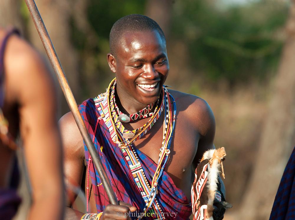 Maasai tribesmen celebrating after Adumu, a traditional jumping contest. Near Amboseli National Park, Kenya