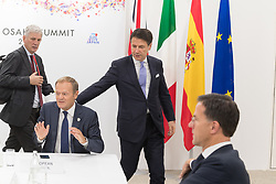 Donald Tusk and Giuseppe Conte.<br /> EU meeting with French President Emmanuel Macron, Prime Minister of United Kingdom Theresa May, German Chancellor Angela Merkel, President of European Commission Jean-Claude Juncker, Prime Minister of Netherland Mark Rutte, President of European Council Donald Tusk, Prime Minister of Spain Pedro Sanchez and Prime Minister of Italy Giuseppe Conte during G20. Osaka, Japan, on June 29, 2019. Photo by Jacques Witt/Pool/ABACAPRESS.COM