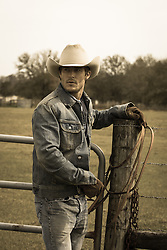 All American good looking cowboy on a ranch