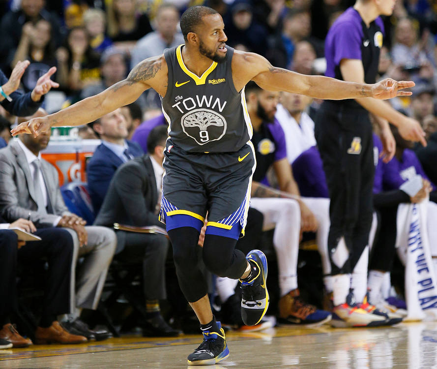 Golden State Warriors guard Andre Iguodala (9) after making a three point basket against the Los Angeles Lakers in the second half of an NBA game at Oracle Arena on Saturday, Feb. 2, 2019, in Oakland, Calif. The Warriors won 115-101.
