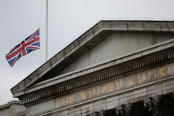 © Licensed to London News Pictures.10/04/2021. London, UK. The Union Flag flies at half mast above The National Gallery. Yesterday Buckingham Palace announced that Prince Philip The Duke of Edinburgh passed away in the morning at Windsor Castle . Photo credit: George Cracknell Wright/LNP