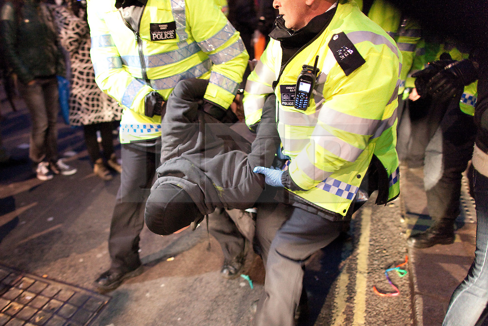 © licensed to London News Pictures. London, UK 08/05/11. Police arrest protesters who had occupied Fortnum and Mason during protests on 26th March. A protest is due to be held outside a City of Westminster Court hearing tomorrow (9th May) in support of UKUncut protesters who occupied Fortnum and Mason during protests in London on 26th March. Protesters say the 26th March demonstration in Fortnum & Mason was peaceful, that they were protesting lawfully, that police told them they'd be free to leave before arresting them and that they should not be prosecuted. FILE PICTURE DATED 26/03/2011. Please see special instructions for usage rates. Photo credit should read Joel Goodman/LNP