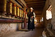 This elderly Tibetan woman is walking koras - circles walked around religious monuments.  Dawu (Dafu), Tibet (China).