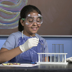 Austin, Texas 27SEP00:   Hispanic junior high science student using mercury thermometer to measure the temperature of water in a test tube in science class.  MODEL RELEASED OK Photo by Bob Daemmrich