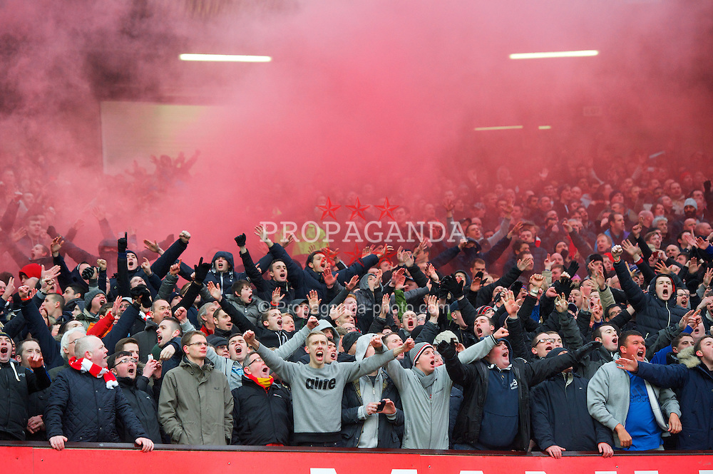 MANCHESTER, ENGLAND - Sunday, January 13, 2013: Liverpool supporters celebrate their side's goal as a red smoke bomb goes off during the Premiership match against Manchester United at Old Trafford. (Pic by David Rawcliffe/Propaganda)