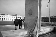 Garda Memorial Unveiled. Mr. Brian Lenihan T.D., Minister for Justice, unveils a Memorial to members of the force who gave their lives in the service of their country, at the Garda Headquarters, Phoenix Park, Dublin. On the left is Commissioner W.P. Quinn..21.10.1966