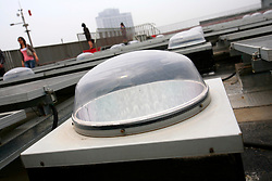 CHINA ZHEJIANG PROVINCE HANGZHOU 21MAY10 - Solar photovoltaic power generation and solatube lighting domes on the rooftop of a building at the Energy and Environment Industial Park outside of the city of Hangzhou, China...jre/Photo by Jiri Rezac..© Jiri Rezac 2010