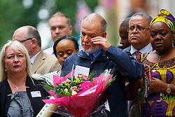 © Licensed to London News Pictures. 07/07/2015. London, UK. George Psaradakis, the bus driver who was on duty when of the 7/7 bombs detonated on the top deck of number 30 bus pays his respects on the 10th anniversary of 7/7 London bombings in Tavistock Square on Tuesday, July 7, 2015. Photo credit: Tolga Akmen/LNP