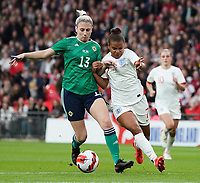 England's Nikita Parris under pressure from Northern Ireland's Kelsie Burrows<br /> <br /> Photographer Stephanie Meek/CameraSport<br /> <br /> FIFA Women's World Cup Qualifying Group D - England Women v Northern Ireland Women - Saturday 23rd October 2021 - Wembley Stadium - London<br /> <br /> World Copyright © 2021 CameraSport. All rights reserved. 43 Linden Ave. Countesthorpe. Leicester. England. LE8 5PG - Tel: +44 (0) 116 277 4147 - admin@camerasport.com - www.camerasport.com