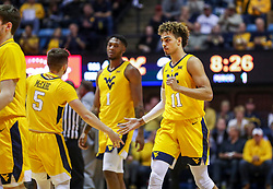 Mar 20, 2019; Morgantown, WV, USA; West Virginia Mountaineers forward Emmitt Matthews Jr. (11) celebrates with teammates during the first half against the Grand Canyon Antelopes at WVU Coliseum. Mandatory Credit: Ben Queen
