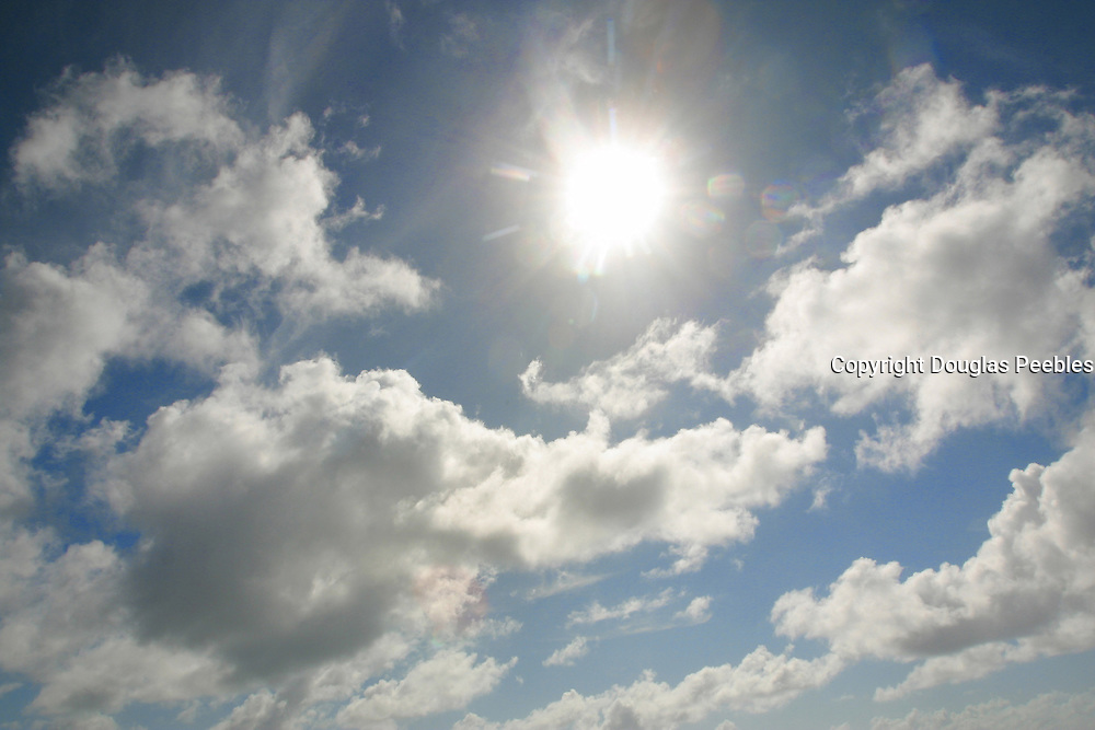 Sky with sun and clouds, South Pacific<br />