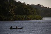 Fishtermen paddle along the San Juan River. Boca de Sábalos, El Castillo, Río San Juan, Nicaragua. January 27, 2014.
