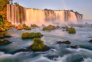The upper falls of the Iguazu Falls in a long exposure time at sunset, Brazil