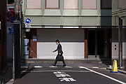A salaryman in a street in Toranomon, Tokyo, Japan. Friday March 10th 2017