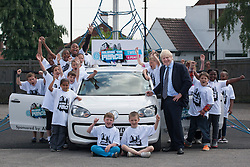 """© licensed to London News Pictures. London, UK 14/06/2012. Boris Johnson signing the """"Peace Car"""" at Cooper's Lane Primary School today (14/06/12). The car is the symbol of 100 Days of Peace initiative organised by Margaret Mizen and Grace Idowu whose teenage son were murdered. Photo credit: Tolga Akmen/LNP"""