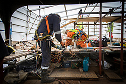 """© Licensed to London News Pictures. 04/05/2016. Birkenhead UK. Picture shows restoration work being carried out on the Daniel Adamson at Camel Laird docks. The Daniel Adamson steam boat has been bought back to operational service after a £5M restoration. The coal fired steam tug is the last surviving steam powered tug built on the Mersey and is believed to be the oldest operational Mersey built ship in the world. The """"Danny"""" (originally named the Ralph Brocklebank) was built at Camel Laird ship yard in Birkenhead & launched in 1903. She worked the canal's & carried passengers across the Mersey & during WW1 had a stint working for the Royal Navy in Liverpool. The """"Danny"""" was refitted in the 30's in an art deco style. Withdrawn from service in 1984 by 2014 she was due for scrapping until Mersey tug skipper Dan Cross bought her for £1 and the campaign to save her was underway. Photo credit: Andrew McCaren/LNP ** More information available here http://tinyurl.com/jsucxaq **"""