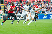 Football - 2017 / 2018 Premier League - Swansea City vs. Manchester United<br /> <br /> Paul Pogba of Manchester United chases—<br /> , at Liberty Stadium.<br /> <br /> COLORSPORT/WINSTON BYNORTH