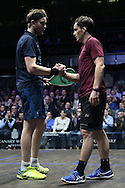 James Willstrop of England (wearing a Dark Blue shirt) winning the match shakes hands with Paul Coll of New Zealand (wearing a Maroon shirt). Canary Wharf Squash Classic 2016 , day two at the East Wintergarden in Canary Wharf , London on Tuesday 8th March 2016.<br /> pic by John Patrick Fletcher, Andrew Orchard sports photography.