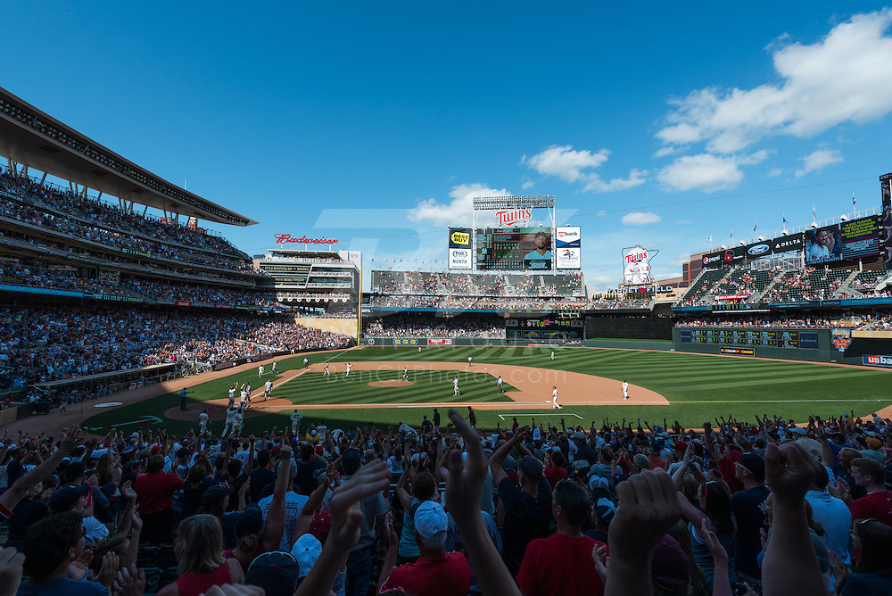 Fans celebrate after the Minnesota Twins defeated the New York Yankees in the 11th inning at Target Field on July 5, 2014 in Minneapolis, Minnesota.  Photo by Ben Krause