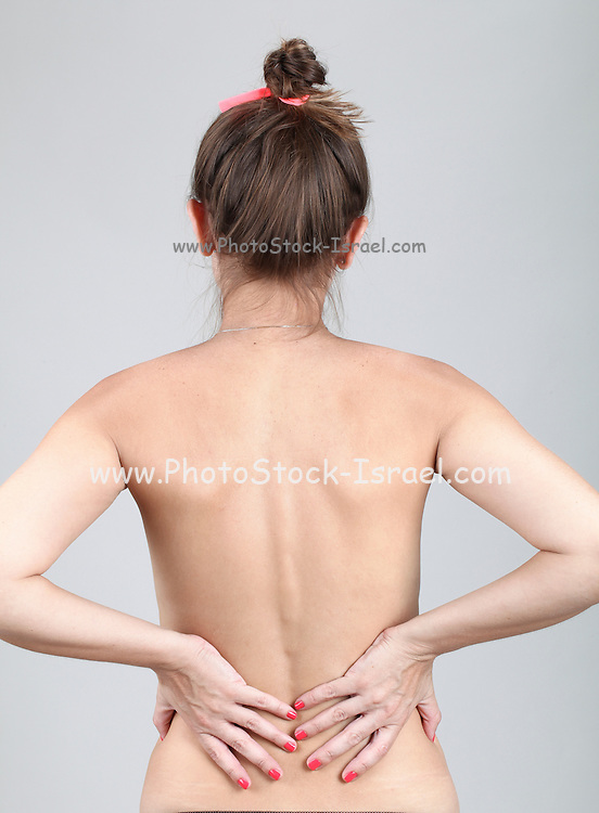Naked Caucasian Woman with lower back pain