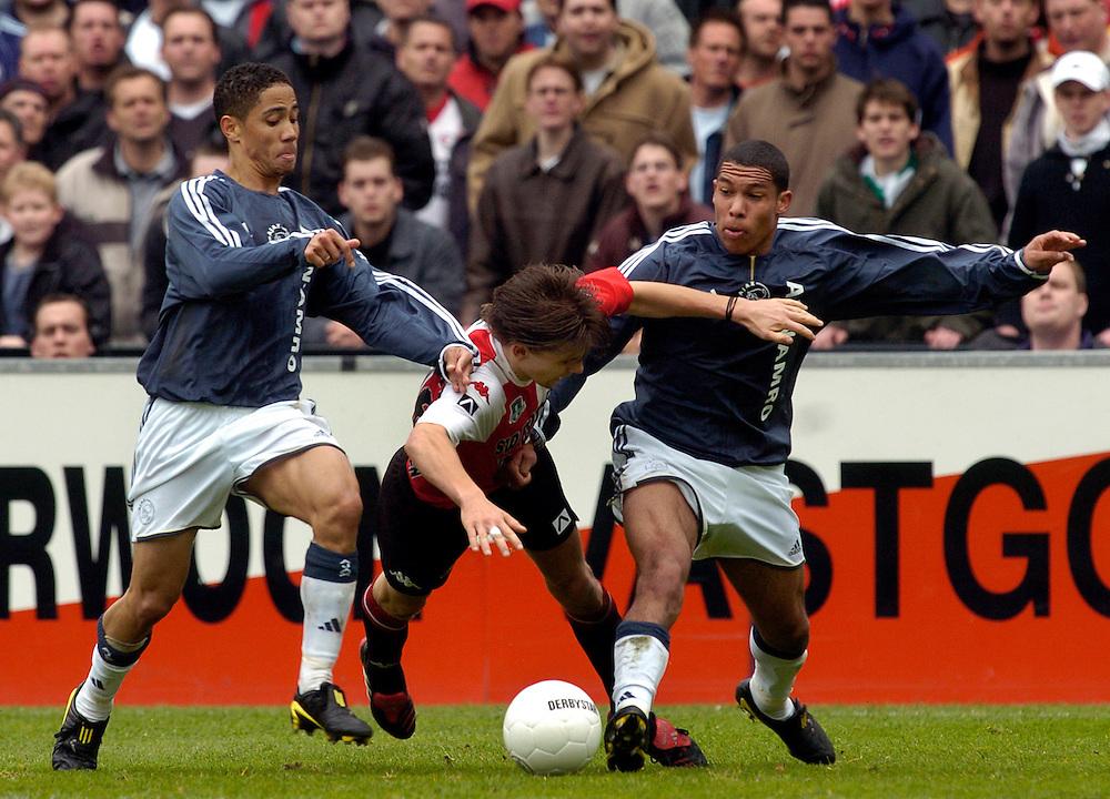 Photo: Gerrit de Heus. Rotterdam. 11/04/04..Feyenoord-Ajax. Vlnr: Steven Pienaar, Ebi Smolarek en Nigel de Jong.