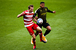 Jonah Ayunga of Bristol Rovers takes on Tom Anderson of Doncaster Rovers - Mandatory by-line: Robbie Stephenson/JMP - 26/09/2020 - FOOTBALL - The Keepmoat Stadium - Doncaster, England - Doncaster Rovers v Bristol Rovers - Sky Bet League One