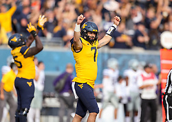 Sep 22, 2018; Morgantown, WV, USA; West Virginia Mountaineers quarterback Will Grier (7) celebrates after throwing a touchdown pass during the third quarter against the Kansas State Wildcats at Mountaineer Field at Milan Puskar Stadium. Mandatory Credit: Ben Queen-USA TODAY Sports