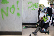 Police arrest protesters who have spray painted the Shell building at the Extinction Rebellion 'Shell Out' protest on 8th September 2020 in London, United Kingdom. The environmental group gathered outside the Shell building to protest at the ongoing extraction of fossil fuels and the resulting environmental record. Extinction Rebellion is a climate change group started in 2018 and has gained a huge following of people committed to peaceful protests. These protests are highlighting that the government is not doing enough to avoid catastrophic climate change and to demand the government take radical action to save the planet.