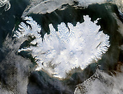 Satellite image of Iceland on  28  January 2004 showing it covered in a blanket of snow and ice which is obscuring the permanent glaciers and icecaps that exist year-round. Credit NASA. Science Winter
