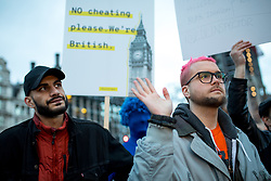 © Licensed to London News Pictures. 29/03/2018. London, UK. Christopher Wylie, the Cambridge Analytica whistleblower, (right) and Shahmir Sanni, former volunteer for Vote Leave, (left) at the 'Rally for a Fair Vote' demonstration on Parliament Square, calling for evidence of cheating on either sides of the Brexit referendum to be brought forward. Cambridge Analytica is being investigated due to accusations of the misuse of Facebook user data to influence electoral outcomes. Photo credit : Tom Nicholson/LNP