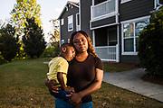 BIRMINGHAM, AL – SEPTEMBER 25, 2019: Antionette Pruitt, 29, holds her 4-year-old son, Axtyn Taylor near their apartment.