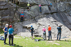 Group of climbers with safety equipment on rock, Otztal, Tyrol, Austria