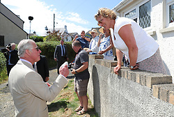 The Prince of Wales meets local residents during a visit to Llangwm, in west Wales.