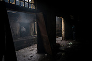 Old warehouses where migrants are living. This old abandoned building have no protection from the wind, no heating and any kind of sanitary. Belgrade, Serbia. January 14th 2016 Federico Scoppa