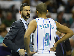 October 17, 2018 - Charlotte, NC, USA - Charlotte Hornets head coach James Borrego talks with Tony Parker (9) during a break in the first half against the Milwaukee Bucks at the Spectrum Center in Charlotte, N.C., on Wednesday, Oct. 17, 2018. (Credit Image: © David T. Foster Iii/Charlotte Observer/TNS via ZUMA Wire)