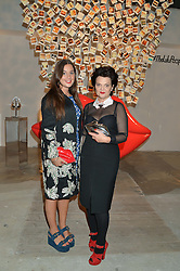 Left to right, TARA GUINNESS and her mother LULU GUINNESS at the launch of The Lulu Perspective to celebrate 25 years of Lulu Guinness held at 74a Newman Street, London on 13th September 2014.