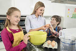 Teacher giving student an egg in home economics class, Bavaria, Germany
