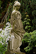 A carved stone statue of a woman in the garden at Newby Hall, Ripon, North Yorkshire, UK