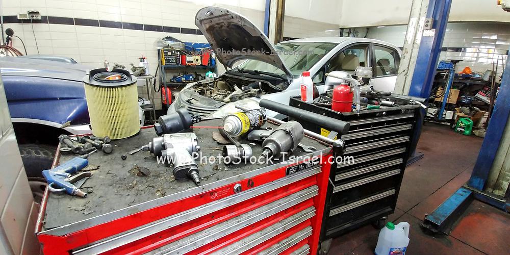 Car being serviced in a garage