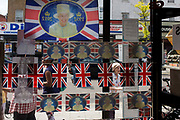 Days before the Queen's Golden Jubilee weekend, elaborate display of patriotic flags and historical royal portraits adorn the window of a Salvation Army charity shop in south London. A few months before the Olympics come to London, a multi-cultural UK is gearing up for a weekend and summer of pomp and patriotic fervour as their monarch celebrates 60 years on the throne and across Britain, flags and Union Jack bunting adorn towns and villages.