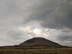 Sepulcher Mountain under a mostly cloudy sky. Yellowstone National Park.