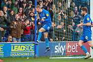 AFC Wimbledon attacker Shane McLoughlin (38) celebrating after scoring goal to make it 2-0 during the EFL Sky Bet League 1 match between AFC Wimbledon and Doncaster Rovers at the Cherry Red Records Stadium, Kingston, England on 9 March 2019.