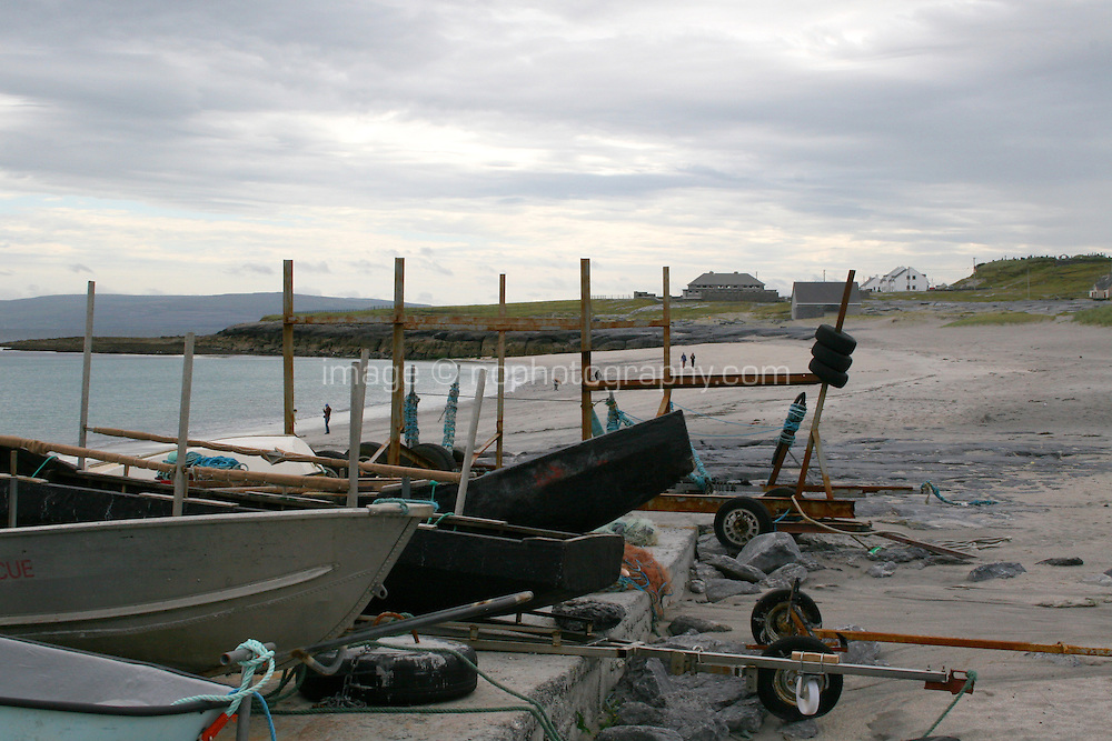 Boats on the beach on Inis Oirr on the Aran Islands Galway Ireland